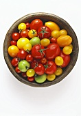 Tomatoes (various types) in wooden dish