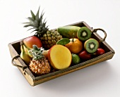 Various exotic fruits on wooden tray