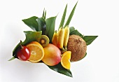 Exotic fruits with orange and coconut on leaves