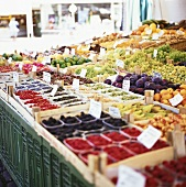 Many different fruits in crates at the market
