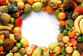 Exotic fruits, laid in a circle around edge of picture