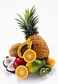 A heap of exotic fruits and pieces of coconut