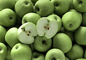 Granny Smith apples, one halved