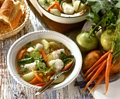 Fish stew with spring vegetables and chervil