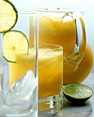 Mango and orange juice in glass jug and glass
