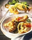 Fried courgette flowers with herb sauce