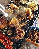 Grilled chicken wings & vegetables on smoking grill