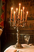 Candlestick with burning candles on a table
