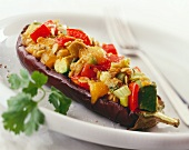 Aubergine half with vegetable stuffing