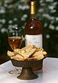 A Dish of Italian Almond Cookies with Dessert Wine