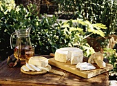 Goat's cheese from Lanzarote on wooden table (outdoors)