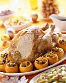 Stuffed turkey on a platter with stuffed oranges