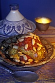 Chicken tajine with almonds and tomato sauce