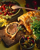 Lamb in puff pastry, piece cut, and vegetables
