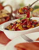 Marinated peppers with olives