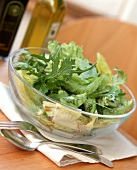 Green salad with oil & vinegar dressing in glass dish