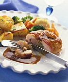 Chicken with sausage and herb stuffing covered in bacon