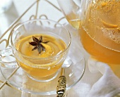 Lemon tea punch with star anise in glass cup