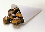 Roasted chestnuts falling out of paper bag