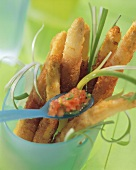 Fried asparagus stalks with tomato dip