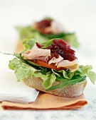 Sandwich with salad, boiled ham and beetroot relish