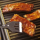 Spare-ribs with barbecue glaze on electric grill
