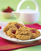 Cookies with walnuts and glace cherries