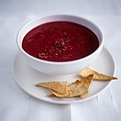 Beetroot soup in bowl, with taco chips
