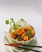 Sweet and sour chicken with rice in dish