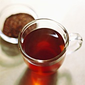 Rooibos tea in glass and unused in bowl