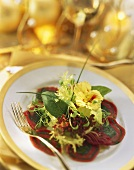 Beef carpaccio rolls with spinach pesto & lettuce garnish