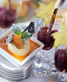 Frozen port wine whip on melon puree & punch jelly