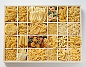 Various pastas in white typesetter's case