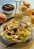Greek potato salad, wine, bread, olives etc on side