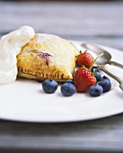 Turnover with berry filling and fresh berries on plate