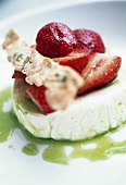 Strawberries on goat's cheese with kiwi sauce