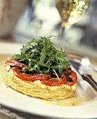 Goat's cheese & aubergine tartlet with tomatoes & rocket