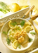 Pasta rolls with salmon filling and fennel with lemon