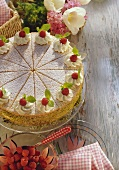 A raspberry cream gateau with pistachio border