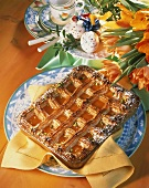 Apricot and almond cake with marzipan lattice