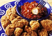 Chicken nuggets with tomato dip