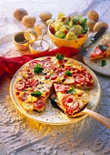 Potato tortilla with tomatoes, pepper and parsley