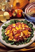 Pumpkin & red cabbage salad with apples on corn salad