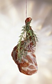 Leg of lamb with sprigs of rosemary
