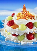 Meringue cream gateau with fruit and spun sugar
