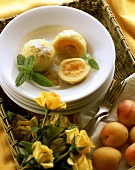 Apricot dumpling on plate; decoration: yellow roses & apricots