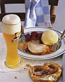 Roast pork with red cabbage & dumpling; weissbier, pretzel