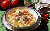 Pasta all'emiliana (ribbon pasta with tomato, rocket, ham)