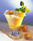 Banana milk shake, decoration: mint leaf & cape gooseberry