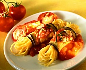 Spaghetti wrapped in aubergine on tomato sauce